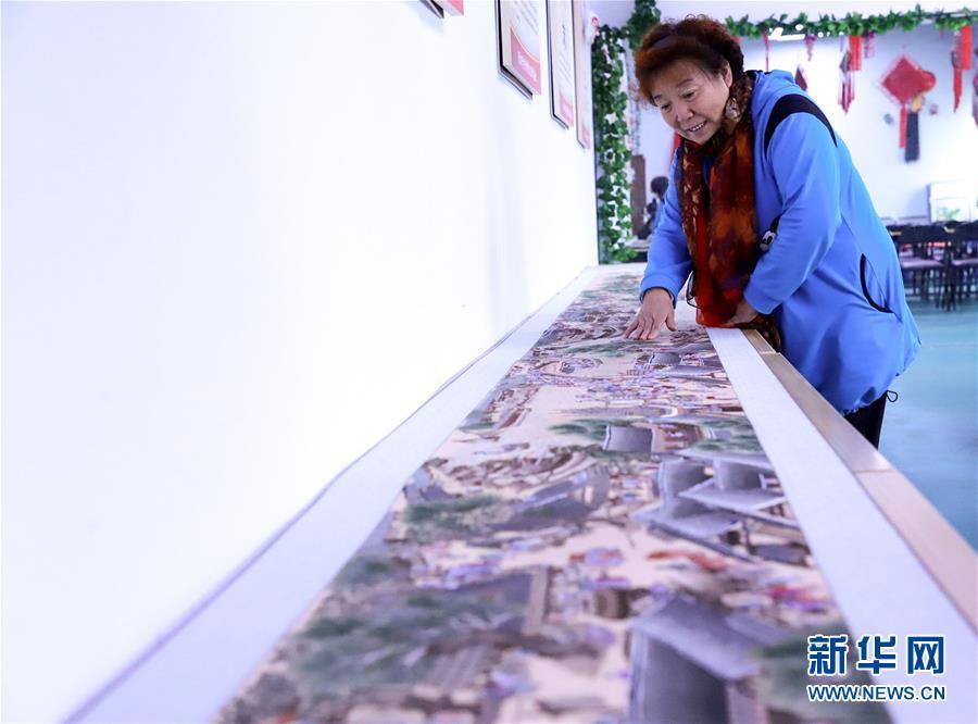 河北刺绣艺人历时4年绣出8米长《清明上河图》