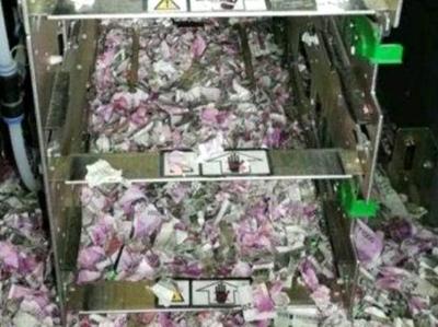 "ATM机遭老鼠""洗劫"" 120万卢比钞票被撕成碎片"