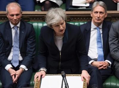 脱欧协议在英国议会遭惨败 首相面临逼宫